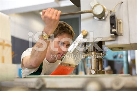 stock-photo-24145212-worker-operates-glass-drilling